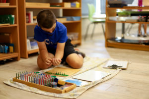 Elementary student working with Montessori Materials